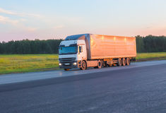 Truck moves on highway. Big powerful truck moves on highway Royalty Free Stock Photos