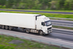 Truck moves on highway. Big powerful truck moves on highway Stock Photography