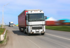Truck moves on highway. Big powerful truck moves on highway Stock Photo