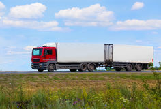 Truck moves on highway. Big powerful truck moves on highway Royalty Free Stock Photography
