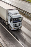 Truck moves on highway. Big powerful truck moves on highway Stock Images