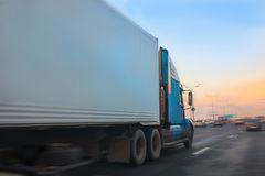 Truck moves on highway. Big truck moves on highway at sunrise Stock Photography