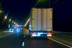 Truck moves on highway at night. Truck moves on country highway at night Stock Image