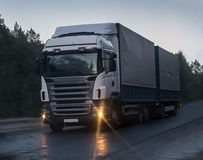 Truck moves on highway at night. Truck moves on country highway at night Royalty Free Stock Photography