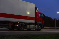 Truck moves on highway at night. Truck moves on country highway at night Stock Photo