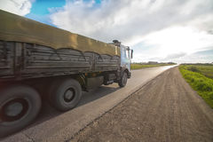 Truck moves on highway at sunrise. Big truck moves on highway at sunrise Stock Image