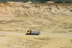 The truck moves on a sandpit. POLEWOJE, KALININGRAD REGION, RUSSIA — JUNE 18, 2014: The truck moves on a sandpit in the sunny summer day Stock Images