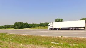 Truck Moving Along Country Road stock footage