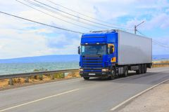 Truck is moving along the highway. Along the seashore Royalty Free Stock Photos