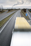 Truck moving fast. Truck moving fast forward on a multi lane highway Royalty Free Stock Photos