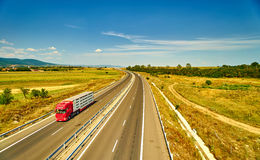 Truck Moving on Highway Stock Images