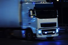 Truck moving on night city. Truck moving in rain on night city Stock Photos