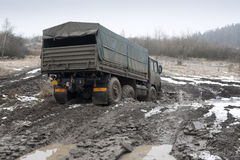 Truck on the muddy road Stock Image