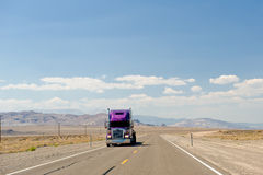 Truck on Nevada desert highway Royalty Free Stock Photos