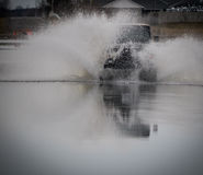Truck off road spray water Royalty Free Stock Photo