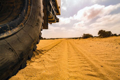 Truck offroad in the desert. Wheel of a big truck in the desert in Morocco. Big Truck offroad in the sand Stock Photography