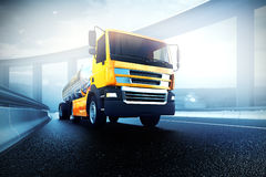 Truck with oil cistern on asphalt road highway. Orange truck with oil cistern on asphalt road highway - transportation background Royalty Free Stock Photography