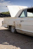 Truck Open. Old wrecked car in a desert junkyard royalty free stock image