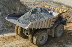 Truck in open pit mine Stock Images