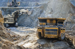 Truck in open pit mine. Dump truck in the open pit mine royalty free stock photography