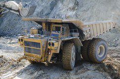 Truck in open pit mine Stock Image