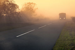 Truck on the open road at sunset Royalty Free Stock Image