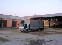 The truck parked near the ramp in the warehouse to load the goods royalty free stock image
