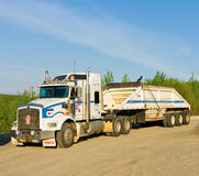 A truck parked at a rest area along the alaska highway Stock Photo