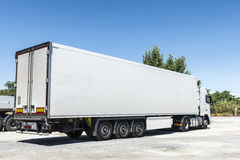 Truck parked. White truck equipped with refrigeration goods parked at a gas station in Spain royalty free stock photo