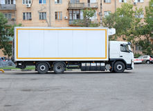 Truck on parking lot near retail store. Royalty Free Stock Images