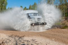 Truck passes through a puddle Royalty Free Stock Photography