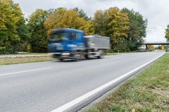 Truck passing by on a national highway, Germany Royalty Free Stock Images