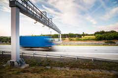 Truck passing through a toll gate on a highway Royalty Free Stock Photos