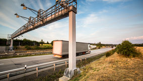 Truck passing through a toll gate on a highway Stock Images