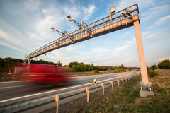 Truck passing through a toll gate on a highway Stock Photos