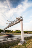 Truck passing through a toll gate on a highway Royalty Free Stock Images