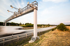 Truck passing through a toll gate on a highway Stock Photo