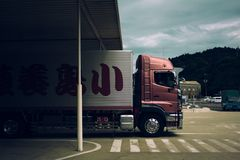 Truck passing by zebra crossing Stock Photography