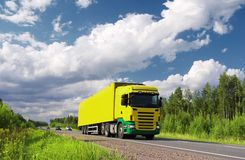 Truck on pictorial highway. Yellow  truck and cars on pictorial highway Scandinavia, polarized landscape Stock Images