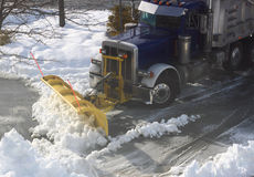 Truck Plowing Snow on Street Royalty Free Stock Photos