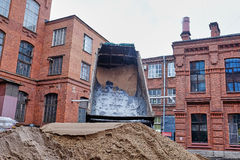 The truck pours the sand Royalty Free Stock Images