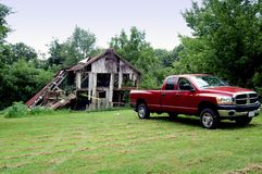 Truck pulling down old barn Stock Photos