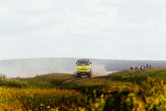 truck rally car driving on dirt road Stock Photo