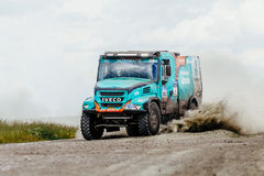 Truck rally car Iveco driving on a dust road Stock Images