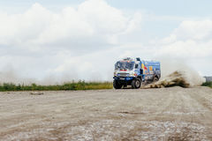 truck rally car KAMAZ turn on a dust road Royalty Free Stock Image