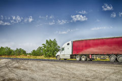Truck with a red trailer Stock Images