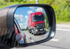Truck reflection in a car mirror Stock Photo