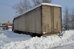 Truck. Refractor. Littered with snow. Snow drifts, unpeeled roads. Impassable snow drifts royalty free stock photos