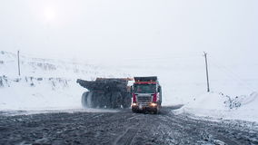 Truck returns from coal mine. Siberia, Russia - January 24, 2015: Mining dump truck driving on snowy road from coal cut in Russia. Machinery for heavy industry stock footage