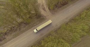 Truck rides on the road through the alley of trees. Truck rides on the road through stock video
